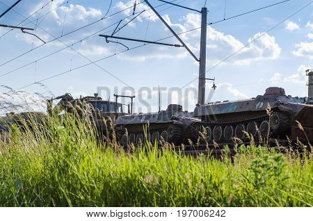Freight train transporting different cargo in containers and different transport