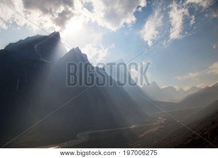 Sun beams in Himalayas mountains way to everest base camp Tabuche peak cholatse and Arakam Tse Nepal