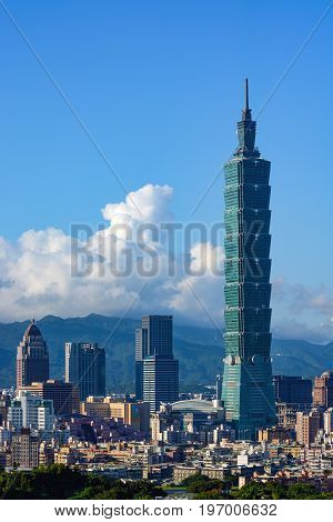 TAIPEI, TAIWAN - AUGUST 7, 2016 - The Taipei 101 building towers over the urban landscape of Taiwan's modern capital