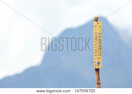 Thermometer on the top of height mountain with 0 or zero degree celsius.