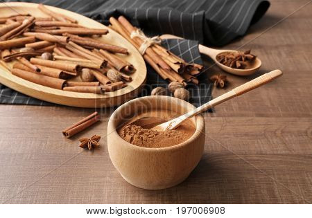 Composition with cinnamon on wooden table
