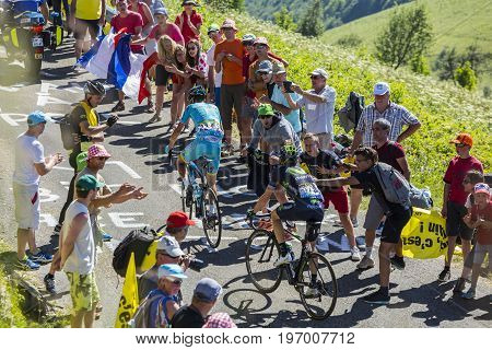 Col du Grand ColombierFrance - July 17 2016: Vincenzo Nibali of Astana Team and Ion Izagirre of Movistar Team riding on the road to Col du Grand Colombier in Jura Mountains during the stage 15 of Tour de France 2016.