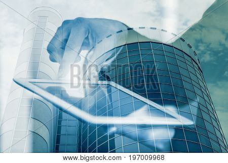 Concept of consulting. Double exposure of cityscape and man using tablet