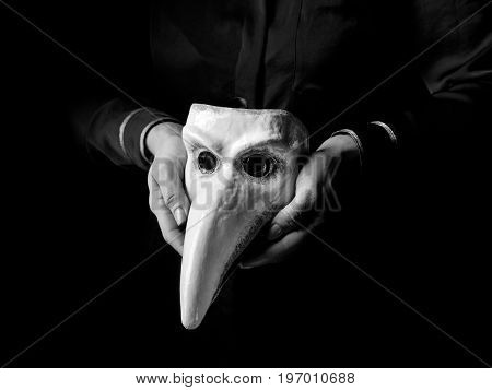 Woman Hands Isolated On Black Background Showing Venetian Mask