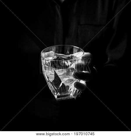 Female Hand Isolated On Black Showing Glass Of Water