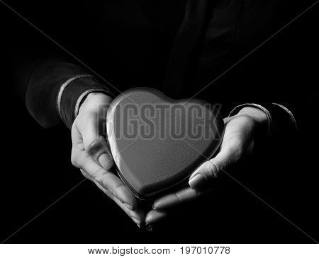 Woman Hands Isolated On Black Showing Heart Shaped Candy Box