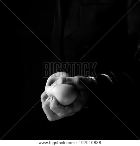 Woman Hand Isolated On Black Using Anti Stress Ball