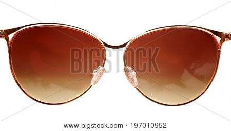 Modern sunglasses on blurred background. Summer vacation concept