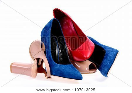 High Heel Footwear Of Different Colours Piled Randomly