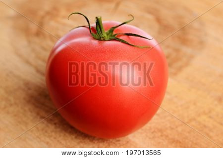 Ripe, Washed Appetizing And Tasty Bright Red Tomatoes On Isolated Wooden Board