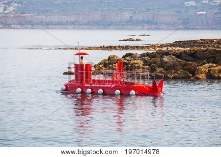 CHANIA, GREECE - APRIL 3, 2017 : Red submarine at the harbour of Chania on Crete, Greece. Chania is the second largest city of Crete and the capital of the Chania regional unit.