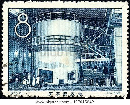 UKRAINE - CIRCA 2017: A postage stamp printed in China shows Chinas first atomic reactor circa 1958