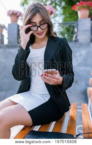 Communication in social media. Secretary chatting, relationships on mobile phone