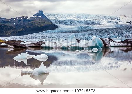 Glacier meltwater form a lake. The sunset over the  Iceland's largest glacier Vatnajokull.  The concept of extreme northern tourism