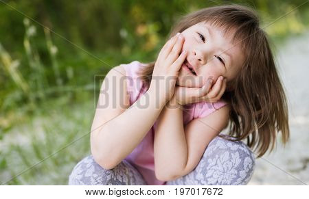 Portrait Of Young Girl With Down Syndrome