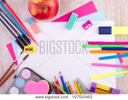 School Supplies On Wooden Desk