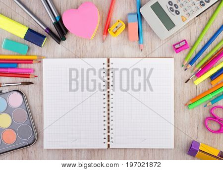 School Supplies On Wooden Desk Wirh Open Notebook