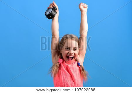 Kid In Pink Dress With Cute Braids Holds Alarm Clock
