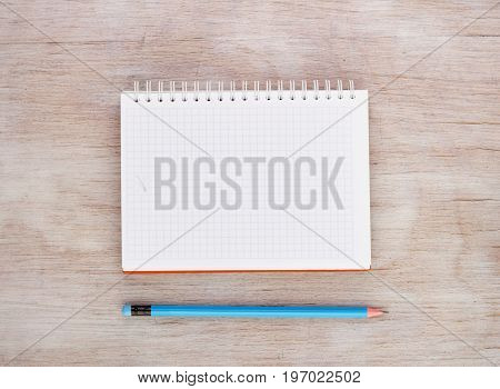 Notebook With Pencil On Desk