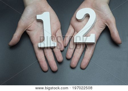 To Female Hands The Number Twelve.