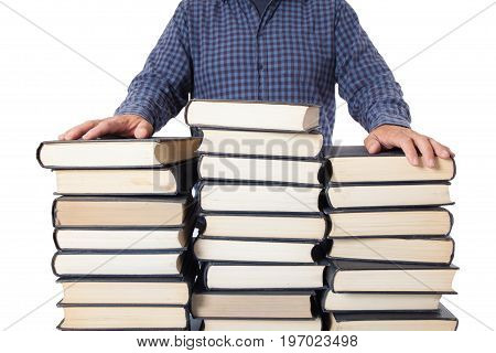 Man with hands on a pile of many old books isolated on white background