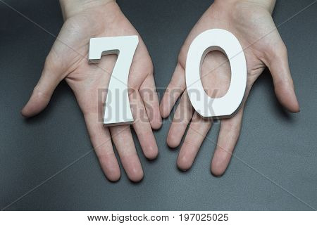 To Female Hands The Number Seventy.