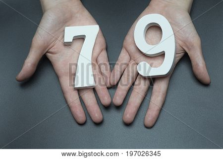 To Female Hands The Figure Of Seventy-nine.