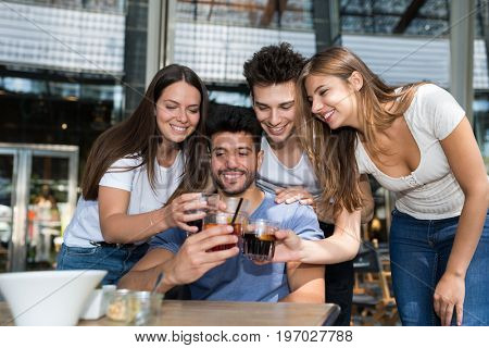 Group of friends having a drink