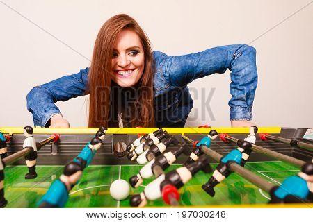 Woman Playing Table Football Game
