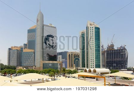 DOHA, QATAR - JULY 26, 2017: Commercial Bank of Qatar's skyscraper shows support for Emir, Tamim bin Hamad al-Thani, during the crisis between the emirate and neighbouring states.