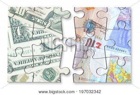 Jigsaw puzzle consisting of dollar and british pound money banknotes over a white background