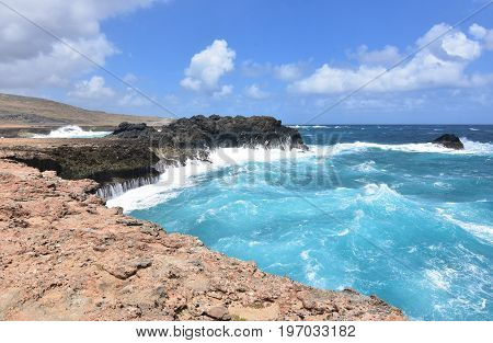 Waves crashing on to the bluffs beside Andicuri Beach in Aruba.