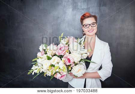 Happy Teacher With Flowers On The Chalkboard Background