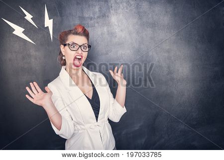 Angry Screaming Teacher On Chalkboard Background