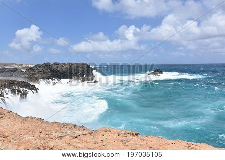 Bluffs with water splashing against them near Andicuri Beach in Aruba.