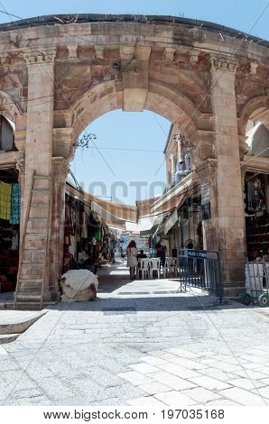 Jerusalem Israel July 14 2017 : Entering the market Suq Aftimos market in Muristan Street in the old city of Jerusalem Israel.