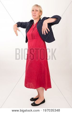 portrait of a attractive blond haired mid aged european woman wearing red dress and black top looking desperate and liftin arms becaus of heat - full body - studio shot on white background.