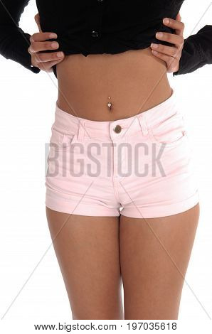A closeup image of the middle section of a young woman in pink shorts and black blouse body part isolated for white background