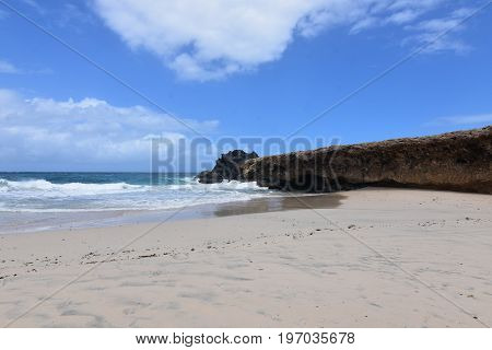 Pretty Andicuri Beach with white sand an a bluff.