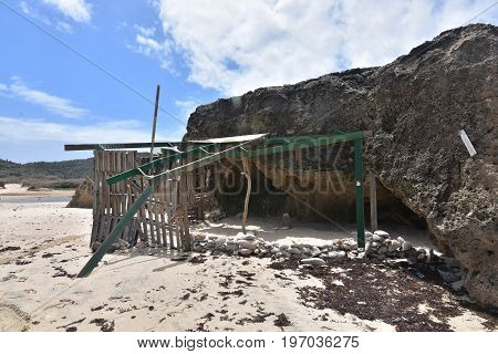 The remains of a ramshackle shade shelter on Andicuri Beach in Aruba.