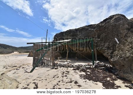 Shelter remains on the secluded Andicuri beach in Aruba.