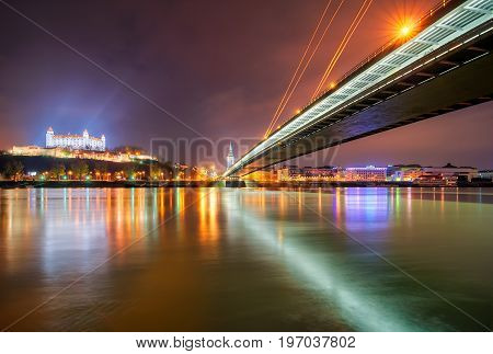 Bratislava castle parliament and Danune river in capital city of Slovakia Bratislava. Beautiful night reflection during winter time.