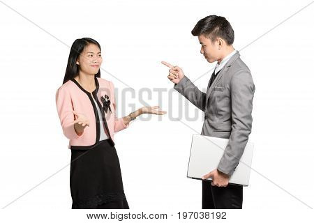 Portrait Of Two Colleagues. Young Furious Man Yelling At Annoyed Stressed Woman With Pointed Finger.