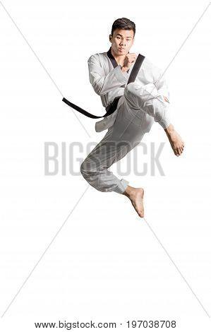 Portrait Of An Asian Professional Taekwondo Black Belt Degree (dan) Jumping For Kick. Isolated Full