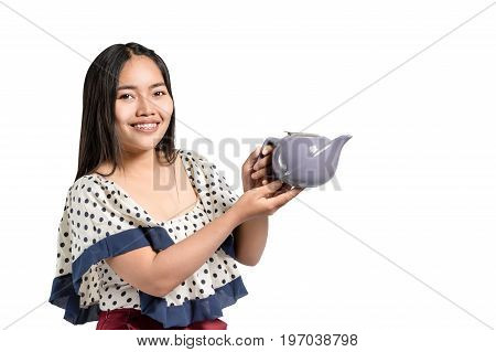 Portrait Of A Beautiful Asian Woman Smiling And Holding Tea Pot In The Hands. Isolated On White Back