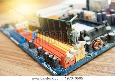 Miniature worker repairing circuit mother board .