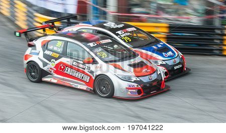 Bang Saen Thailand - July 1 2017: WS Lai Malaysia and Tin Sritrai Thailand fighting for positions during TCR Asia Series at Bang Saen Street Circuit in Bang Saen Thailand.