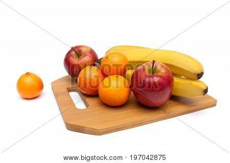 apples tangerines and bananas close-up. white background - horizontal photo.