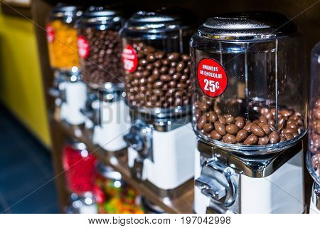 Chocolate Covered Almonds In French Coin Dispenser Candy Machines