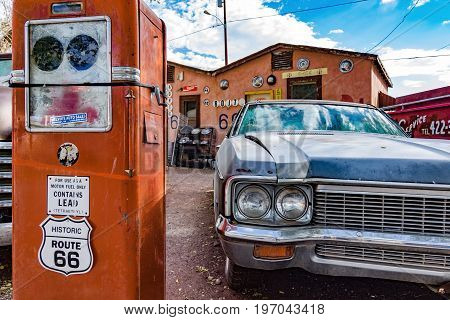 Old car and historical gasoline pump on Route 66